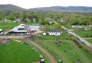 The auction is underway. In the background, East Middlebury has already been enveloped by the spring foliage.