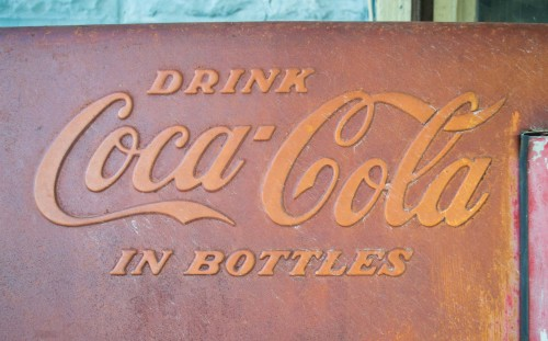 Coca-Cola introduced this slogan in 1910, five years before the curvy bottle.