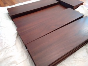 The black walnut veneer on the shelves is in excellent condition.